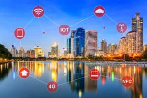 Concept of smart city illustrated by networking and internet of things or IOT.