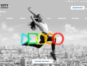 """Smart City World Congress Screenshot: Woman jumping with """"olympic rings"""" around her."""